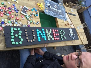 Phoebe working on some bottle cap signage
